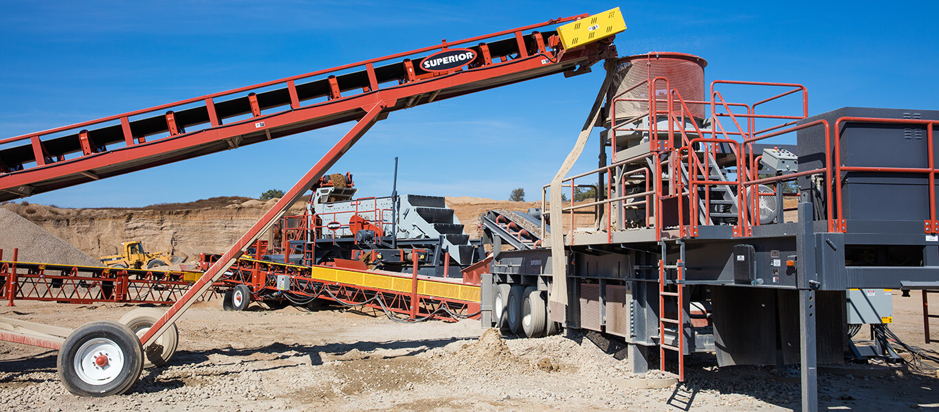 transfer conveyor feeding Patriot Cone Crusher manufactured by Superior Industries.