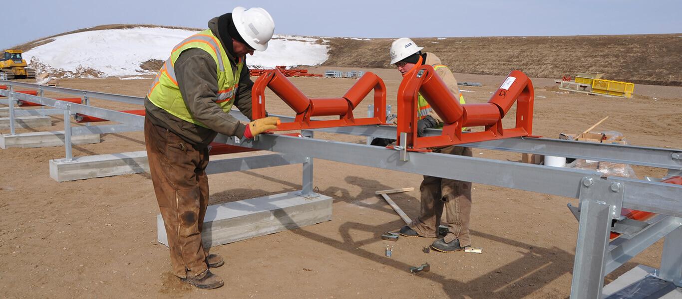 Workers installing pre-engineered modular overland conveyor.