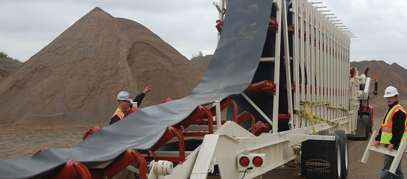 operators setting up the Trailblazer® Conveyor